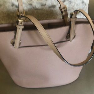 Pink purse with cream handles